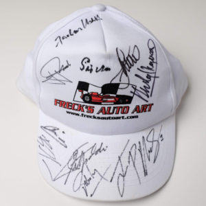 Freck's Auto Art Cap Signed by Penske, Moss, Montoya, Fittipaldi + 7 more